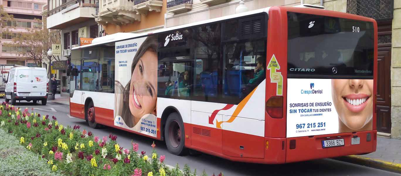 Diseño gráfico Albacete, diseño de vinilos autobuses, diseño publicidad autobuses Albacete Crespo Dental